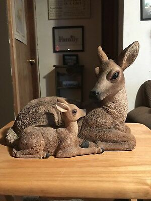 doe and fawn laying down yard statue