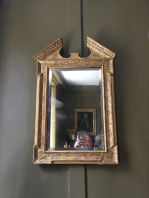 Early 18th century georgian carved giltwood architectural mirror c.1730