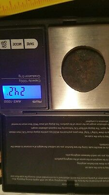 unknown gold or bronze colored coin metal detector find