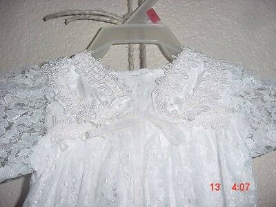 infant baptism gown, white lace with trim, handmade, lined, in good condition..