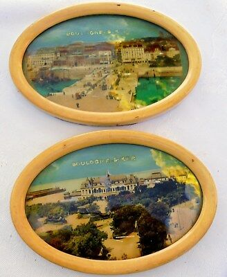 Pair of Antique pictures in oval frames with the original glass and backings.