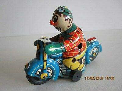 altes Huki Clown-Blechmotorrad