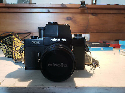 Minolta XK 50mm camera with strap and case.