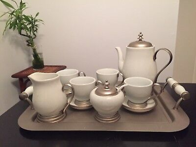 vintage ceramic coffee/tea pot set with trim polished pewter and serving tray.