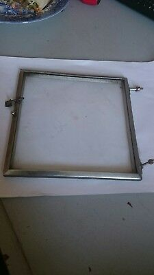 Antique clock bezel with catch and nuts