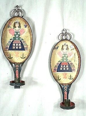 PAIR OF EARLY 20th CENTURY OVAL BACK TIN SCONCES WITH PAINTED FIGURES