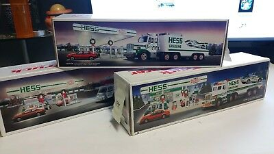 3 toy truck lot - 1988 1989 1991 HESS Fire Truck Truck and racer MIB never opene