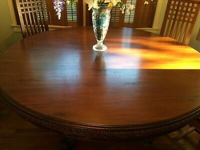 Large Round Solid Mahogany Dining Table with gorgeous carvings on base and edges