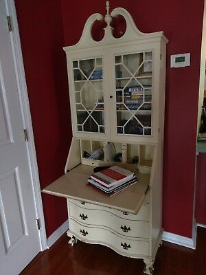 secretary desk with glass doors painted cream color. Very loved family piece