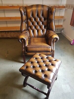 Chesterfield high back chair and stool.