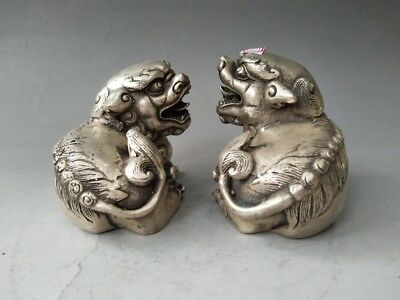 Chinese pure hand-carved white copper lion sculpture