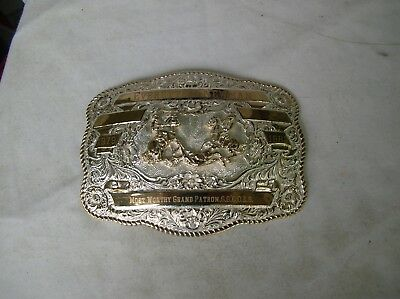 "a very nice silver plate belt buckle 7"" by 5 3/4"" given to Everette h. newman"