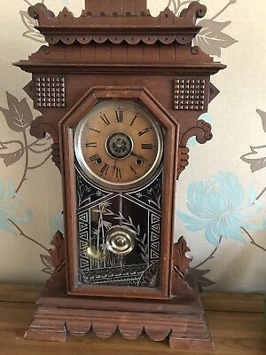 A Victorian Ansonia American Gingerbread/Shelf Clock With Alarm