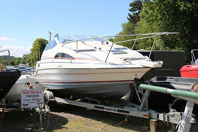 Bayliner 2255 Cabin cruiser with twin axle trailer(missing a wheel and brakes)