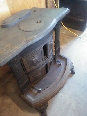 Antique Wood Stove: free standing, cast iron. Burns wood, coal, or briquettes.