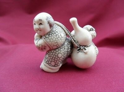 Japan netsuke Karako and monkey carrying a bottle