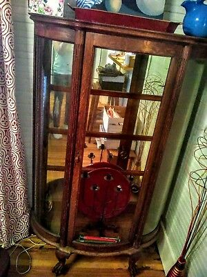 Beautiful vintage antique hutch, claw feet, with glass shelves and mirror.