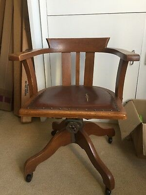 Vintage wooden oak swivel office chair on castors