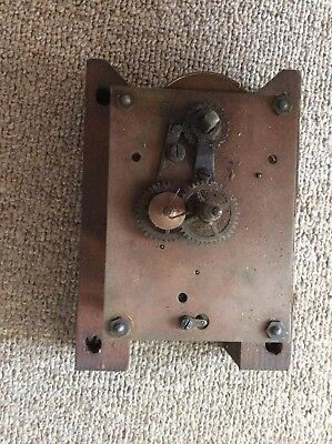 Antique clock movement for restoration.
