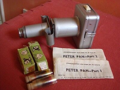 Vintage1951 child's tin film projector, 2 Disney film strips Peter Pan + story