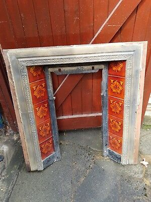 Victorian cast iron fireplace surround with tiles