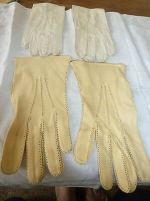 Two pairs of gloves one white leather size 7 one cream Simplex Size 8