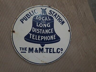 "THE M & M.TEL.CO Porcelain sign measures 12"" approx ROUND"