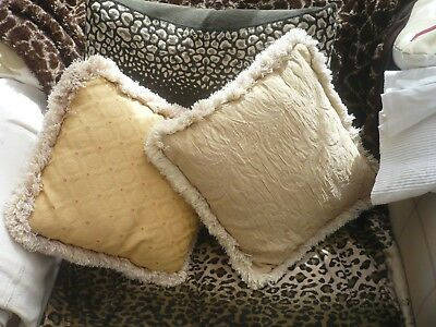2 Antique pretty embossed fabric cushions with thick braiding around the edge