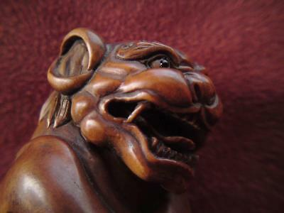 Rare fine quality wood carving signed Netsuke snarling devilish dog lion