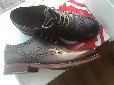 Leather sharp brogue in tan by Grenson. Size UK 9. In Box
