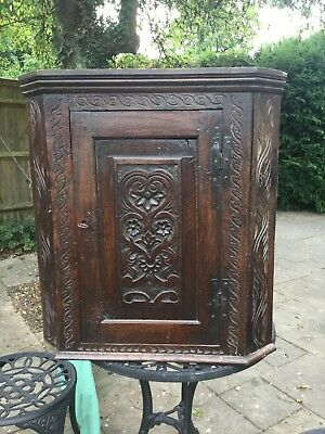 dark oak antique cupboard, corner, carved, with two shelves and an original lock