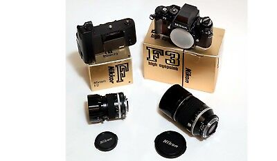 Nikon F3HP SLR camera in box with MD-4 motor drive and two Nikkor lenses.