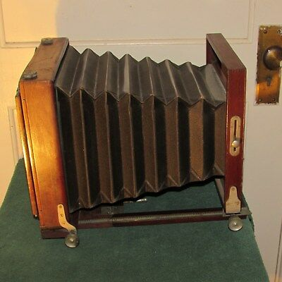 """Antique Eastman Optical Co.""""The Ideal"""" folding camera for repair."""