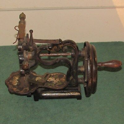 Antique small hand crank sewing machine