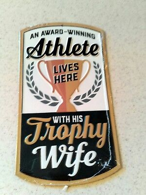 An Award Winning Athlete Lives Here With His Trophy Wife Embossed Metal Sign