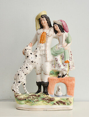 A Large c19th Staffordshire Group, Dalmation Style Dog beside Couple