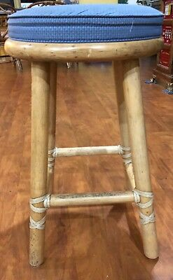 One Vintage McGuire Bamboo Rattan Counter height bar stools with brass tags