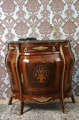 Splendid chest of drawers antique style black wth gold leafs decor from a castle