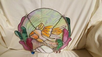 Stained glass window hanging.  Colorful fish.  A beautiful piece for any room.