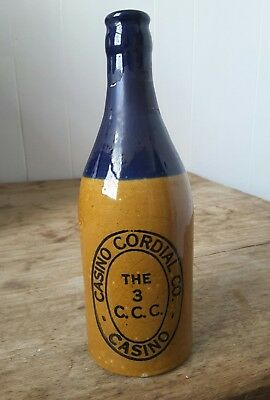 Rare Casino Cordial tan blue top ginger beer bottle crown seal  Fowler Pottery