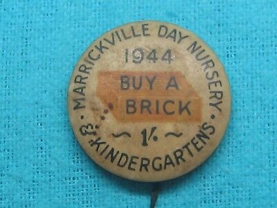 1944 Marrickville Day Nursery BUY A BRICK DAY TIN BACK BADGE