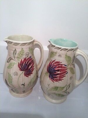 E Radford  Pair of large pitchers/jugs