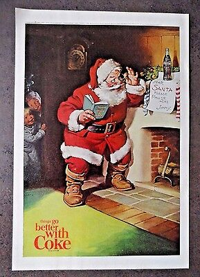1963 Coca Cola COKE Ad - Santa reading list of good boys & girls by the Chimney