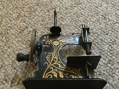 Antique miniature sewing machine-made in Germany-works!!