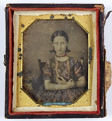 Sharp Hand Tinted 6th Plate Daguerreotype of a Pretty Girl Holding something