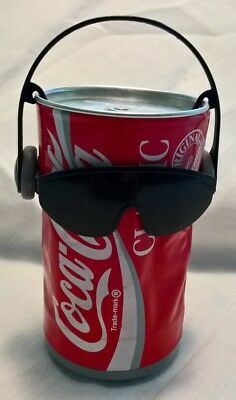 Coke AM transistor radio and Coke dancing can, set of two items