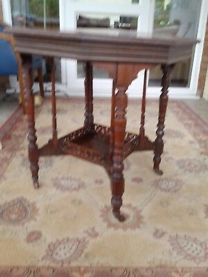 Edwardian octagonal table in mahogany. Genuine antique,but has small split .