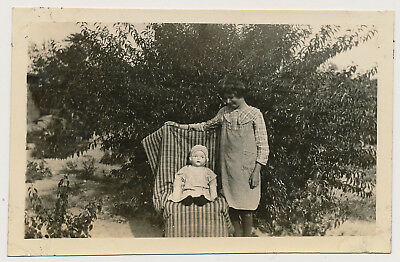 YOUNG GIRL DISPLAYS DOLL on CHAIR BLANKET BACKDROP vtg 20's SNAPSHOT photo