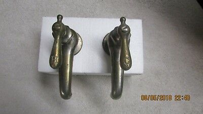 Pair of antique brass sink faucets.