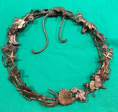 "Petite choses 13"" wreath 34 brass western figures on brass lariat"